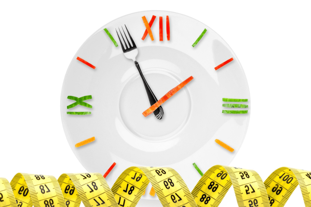 plate with numbers in strips of peppers, hour hand is a fork, tape measure on the bottom