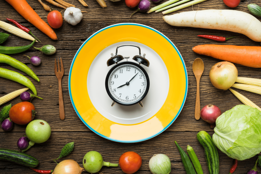 yellow plate with clock in the middle, surrounded by fruits and vegetables