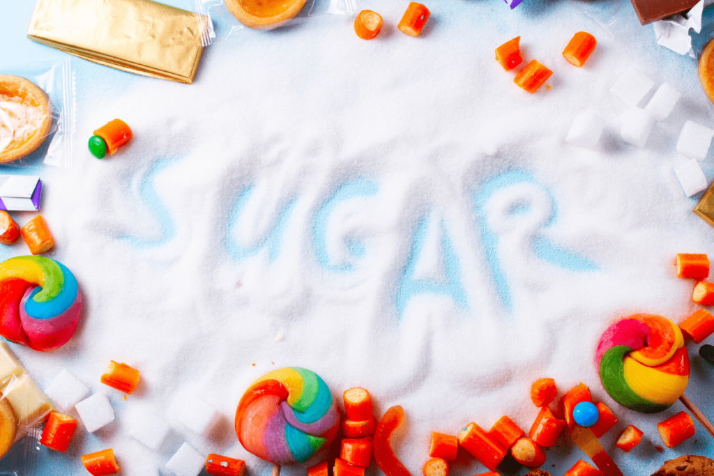 the word sugar written in sugar surrounded by sweet, sugary candy