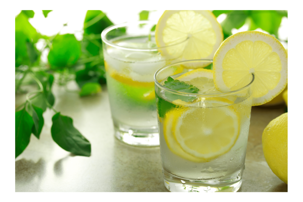two glasses of water with lemon slices and mint leaves